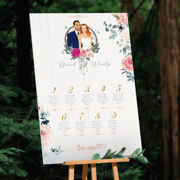 Plan de table de mariage original thème bohème chic attrape rêves. Couple en dessin d'après vos photos sur fond blanc avec fleurs des champs pastel rose et bleu Création : studio postscriptum.